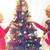 smiling family decorating christmas tree at home stock photo © dolgachov
