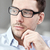 portrait of businessman in eyeglasses at office stock photo © dolgachov
