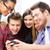 studenti · guardando · smartphone · scuola · istruzione · tecnologia - foto d'archivio © dolgachov