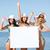csoport · boldog · nők · sapkák · napozás · tengerpart - stock fotó © dolgachov
