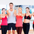 group of people in the gym showing thumbs up stock photo © dolgachov