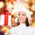 mosolygó · nő · mikulás · segítő · kalap · ajándék · doboz · karácsony - stock fotó © dolgachov