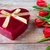 close up of red tulips and chocolate box stock photo © dolgachov