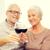 boldog · idős · pár · szemüveg · vörösbor · család · ünnepek - stock fotó © dolgachov