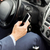 close up of man hand with smartphone driving car stock photo © dolgachov
