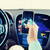 close up of man hand with smartphone driving car foto stock © dolgachov