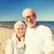 seniors taking picture with selfie stick on beach stock photo © dolgachov
