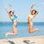 meisjes · bikini · springen · strand · zomer · vakantie - stockfoto © dolgachov
