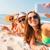grupo · sorridente · mulheres · praia · férias · de · verão - foto stock © dolgachov