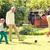 nino · jugando · fútbol · padre · nieto · jardín - foto stock © dolgachov
