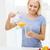 glimlachende · vrouw · glas · sinaasappelsap · home · gezondheidszorg · voedsel - stockfoto © dolgachov
