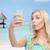 plaży · wakacje · podróży · kobieta · telefonu - zdjęcia stock © dolgachov
