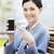 young smiling businesswoman showing smartphone stock photo © dolgachov