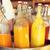 bottles of juice in ice bucket at market stock photo © dolgachov