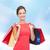 fiatal · nő · ruha · piros · bevásárlótáskák · emberek · ajándékok - stock fotó © dolgachov