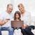 família · feliz · laptop · cartão · de · crédito · casa · família · férias - foto stock © dolgachov