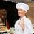 mosolyog · női · szakács · mutat · ok · kézjel - stock fotó © dolgachov