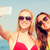 two smiling women making selfie on beach stock photo © dolgachov