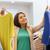 gelukkig · jonge · vrouw · kiezen · kleding · mall · verkoop - stockfoto © dolgachov