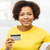 happy african woman with credit or debit card stock photo © dolgachov