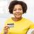 feliz · africano · mulher · laptop · cartão · de · crédito · pessoas - foto stock © dolgachov
