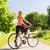 jonge · vrouw · paardrijden · fiets · park · vrouw · bos - stockfoto © dolgachov