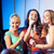three happy women singing on night club stage stock photo © dolgachov