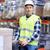 man on forklift loading boxes at warehouse stock photo © dolgachov