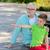 grand-père · petit-fils · séance · rivière · famille · génération - photo stock © dolgachov