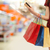 woman with shopping bags and credit card at store stock photo © dolgachov