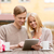 couple with tablet pc in cafe stock photo © dolgachov