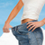 close up of female showing big jeans stock photo © dolgachov