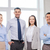 happy business team in office stock photo © dolgachov