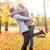 szerelmespár · ősz · park · égbolt · lány · felhők - stock fotó © dolgachov