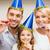 glimlachend · familie · Blauw · hoeden · gunst - stockfoto © dolgachov