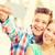 молодые · улыбаясь · пару · автопортрет · смартфон - Сток-фото © dolgachov