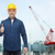 smiling male builder in helmet showing thumbs up stock photo © dolgachov
