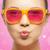 menina · rosa · óculos · de · sol · beijo · amor - foto stock © dolgachov