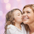 happy little girl hugging and kissing her mother stock photo © dolgachov