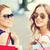 sonriendo · nina · gafas · de · sol · caminando · calle · compras - foto stock © dolgachov