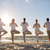 group of people making yoga in tree pose on beach stock photo © dolgachov