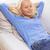 smiling young woman lying on sofa at home stock photo © dolgachov