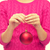 close up of woman in sweater with christmas ball stock photo © dolgachov