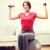 smiling redhead girl exercising with fitness ball stock photo © dolgachov
