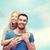 mosolyog · pár · ölel · szeretet · család · égbolt - stock fotó © dolgachov