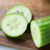 close up of cucumber on wooden cutting board stock photo © dolgachov