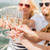 happy friends with glasses of champagne on yacht stock photo © dolgachov