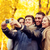 group of smiling men and women making selfie stock photo © dolgachov