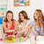 happy friends or teen girls eating sweets at home stock photo © dolgachov