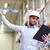 happy businessman with clipboard at warehouse stock photo © dolgachov